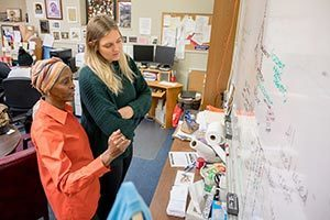 Senior Rebecca Nunge, left, visits with Debra Stanley, founder of the nonprofit Imani Unidad. Photo by Matt Cashore/University of Notre Dame.