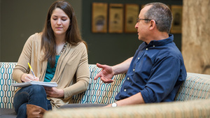 Doctoral student Anna Fett talks with Asher Kaufman, professor of history and the John M. Regan Jr. Director of the Kroc Institute