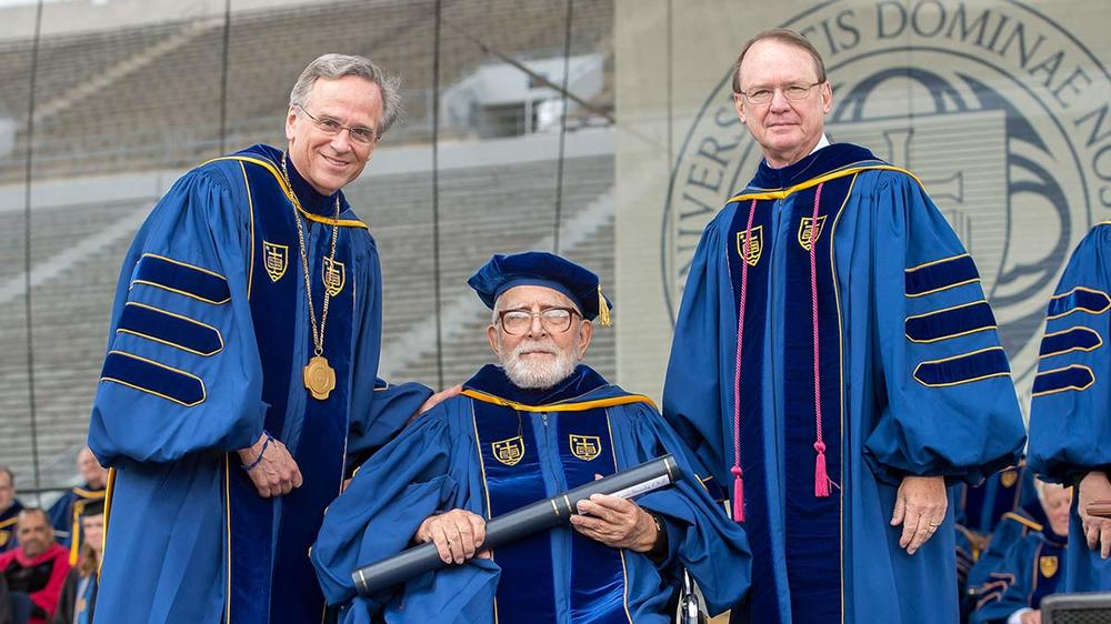 Rev. Thomas F. Stransky, C.S.P. poses for a photo with University of Notre Dame President Rev. John Jenkins, C.S.C. (left) and Notre Dame Board of Trustees Chairman Richard Notebaert after being awarded an honorary doctorate at the 2015 Commencement ceremony. Photo by Matt Cashore/University of Notre Dame.