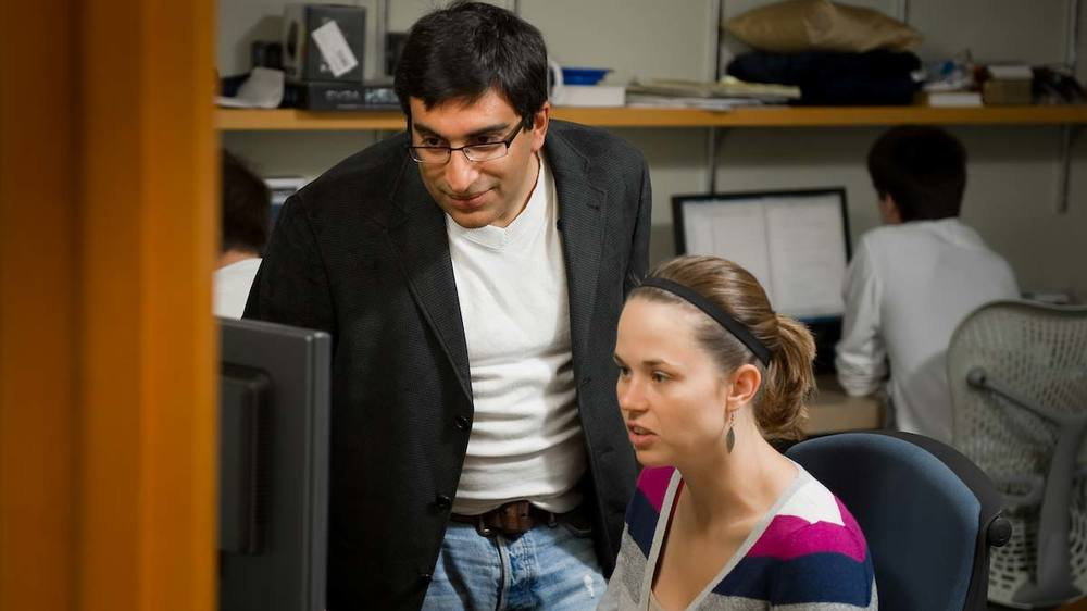 Professor Nitesh Chawla works with a student in the Center for Network and Data Science. Photo by Matt Cashore/University of Notre Dame.