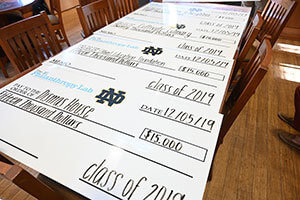 At an awards ceremony Dec. 5, the students presented novelty checks. Photo by Matt Cashore/University of Notre Dame.