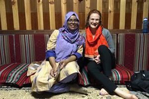 Annie Foley visits with Notre Dame University Bangladesh student Sanzida Sharmeen.