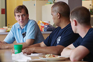 Graham Peaslee talks with firefighters