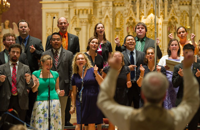 In August 1993, the Folk Choir was one of a handful of American choirs invited to sing for World Youth Day in Denver, Colorado, and for His Holiness John Paul II at the concluding Papal Liturgy.  It is under the direction of Steven Warner along with assistant director Karen Schneider-Kirner.