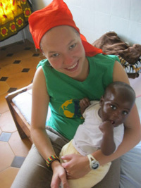 Marta Michalska holds a child at an orphanage in Tanzania