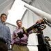 Nicholas Lehner and Chris Howk standing next to the Napoleon Telescope