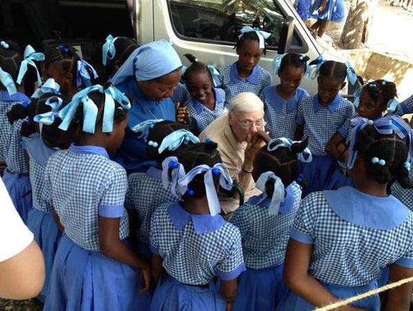 Emil T. Hofman greets the students of St. Rose of Lima School in Leogane, Haiti