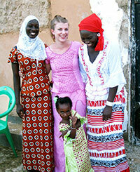 Peace Corps volunteer Lisa Floran with her host family in Senegal
