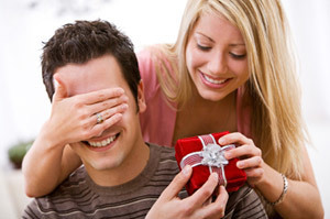 A man and woman exchanging a gift