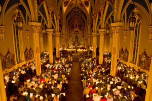 The candle-lighting ceremony at Easter Vigil Mass