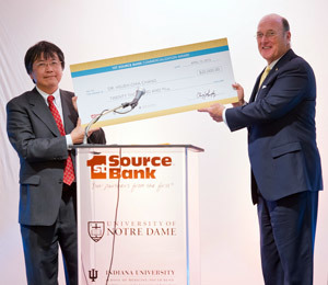 College of Engineering professor Hsueh-Chia Chang receives a ceremonial check from Chris Murphy, Chairman and CEO of 1st Source Bank after winning the 2013 1st Source Bank Commercialization Award